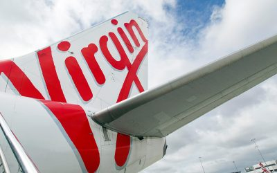 Occidental, Serba Dinamik, Omani Corporates Downgraded; Bain Cap to Buy Virgin Australia